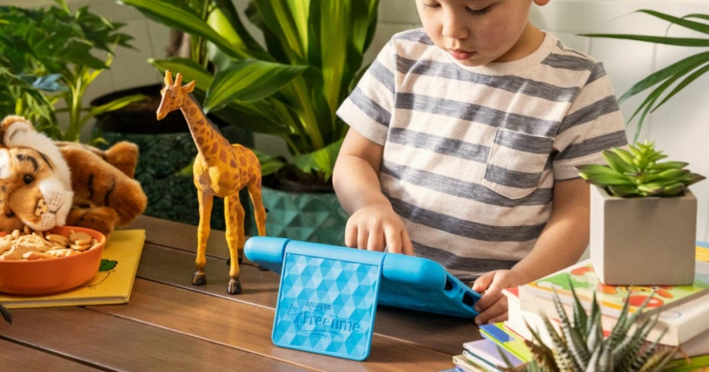 a child playing on a tablet that is in a blue case