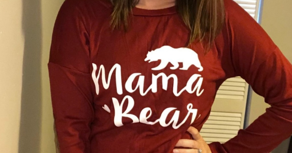 Woman wearing a Mama Bear printed women's tee in wine red