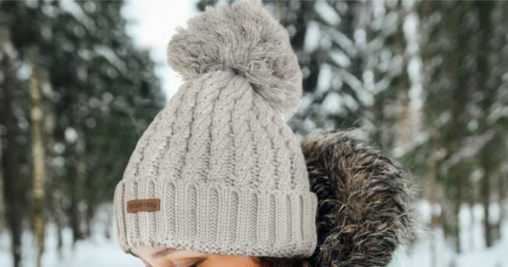 Woman wearing a beanie hat outside