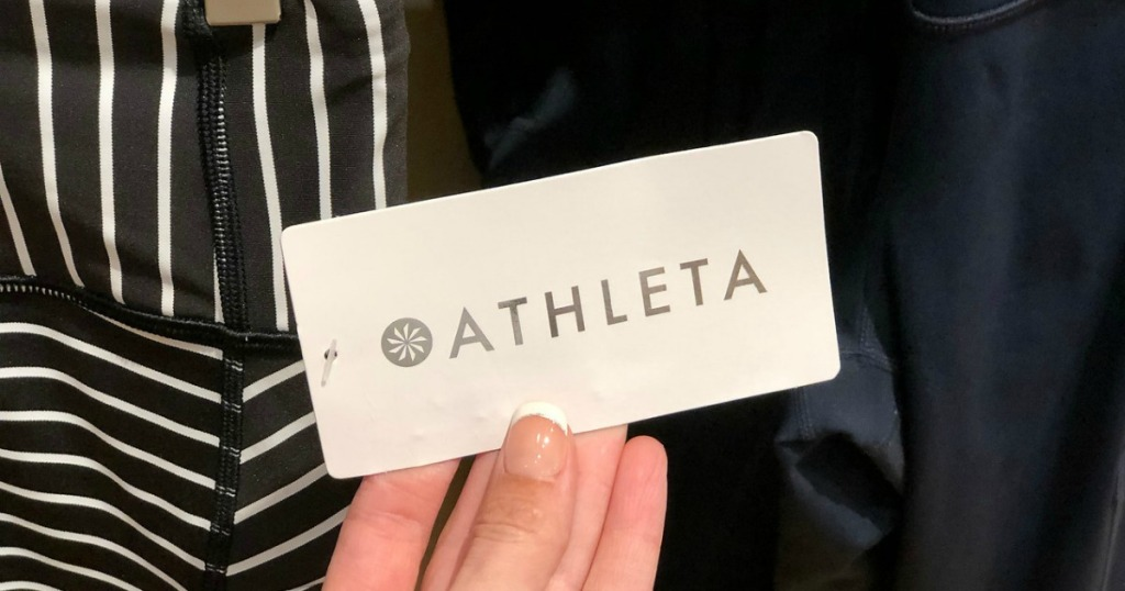 woman holding Athleta Tag