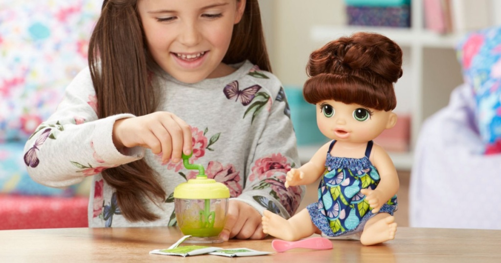 girl playing with baby alive doll