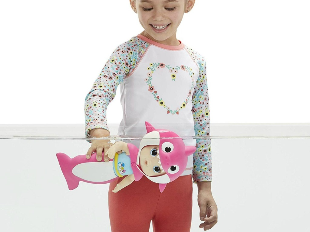 girl playing with Baby Alive Baby Shark Blonde Hair Doll