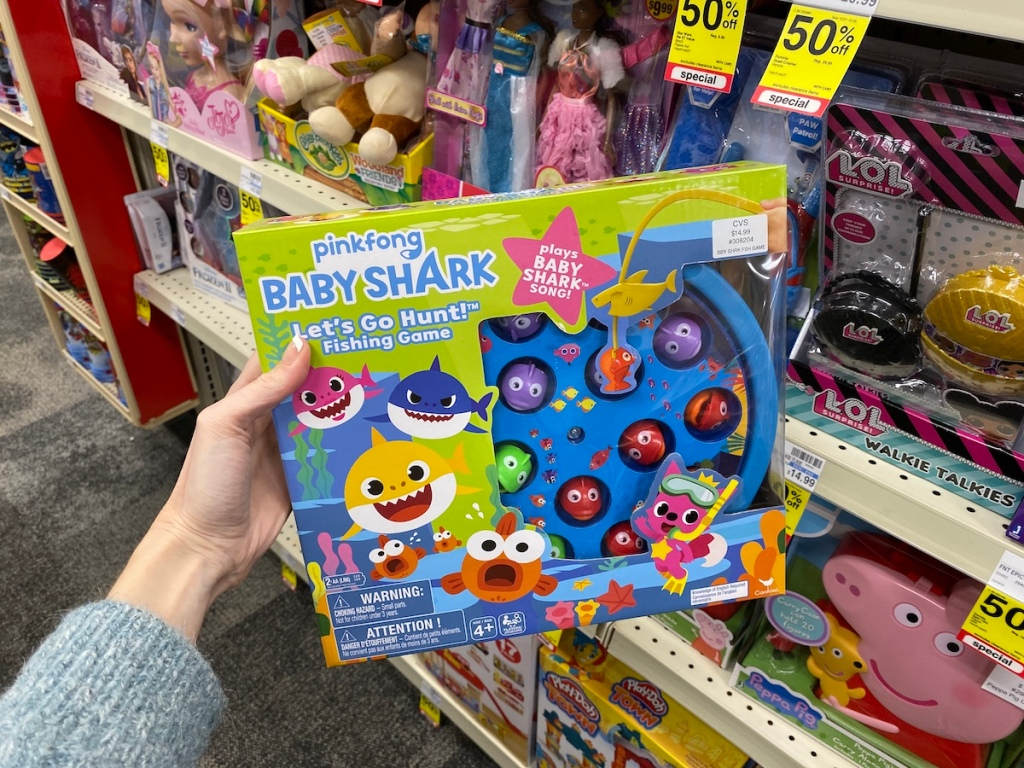 hand holding a Baby Shark Fishing Game