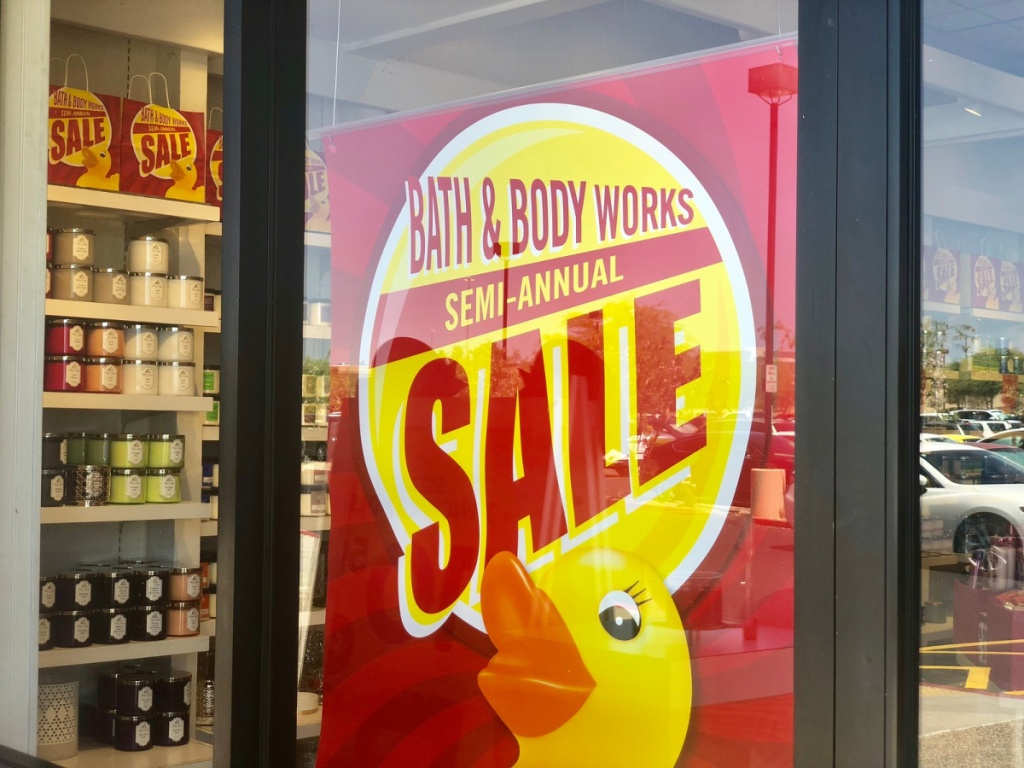 bath & body works semi annual sale sign on door at store