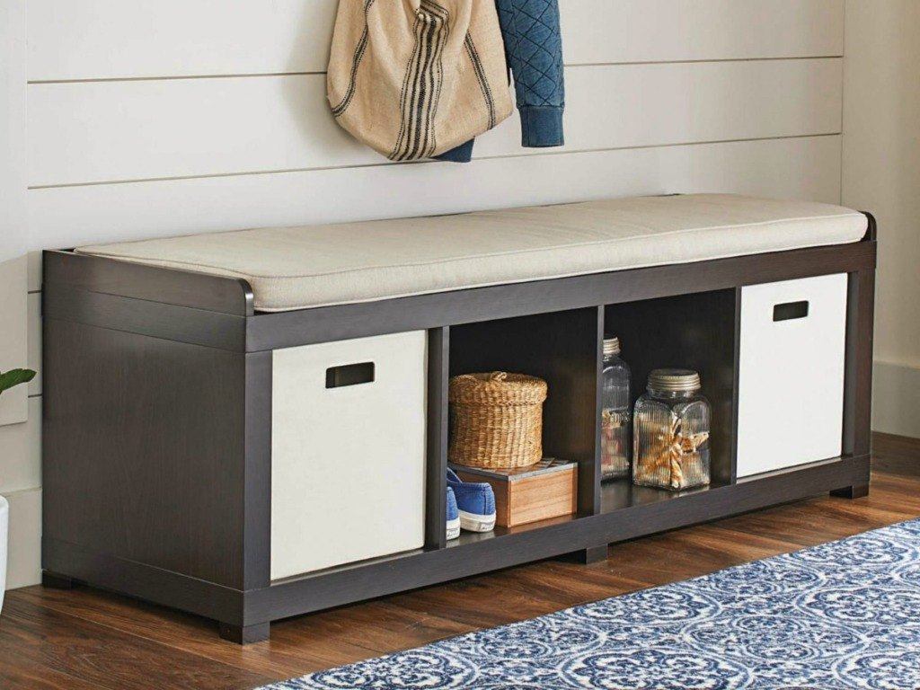 Storage bench with four storage areas in doorway