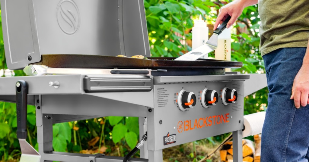 man cooking on Blackstone Proseries Griddle