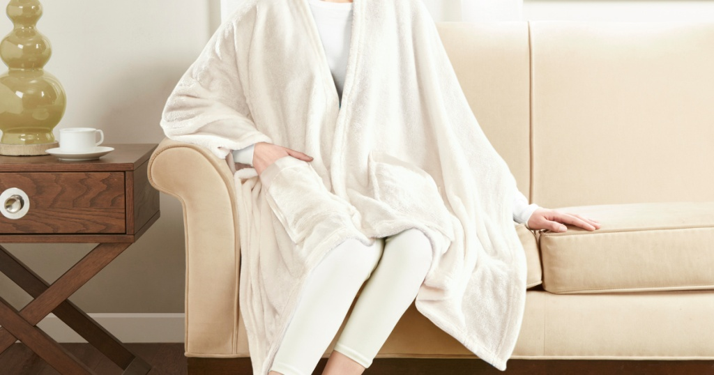 Woman wearing Giftable and Wearable Angel Wrap Plush Throw Blanket with Pockets