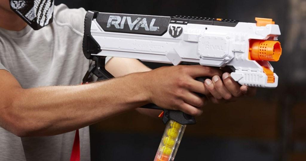 Man's hands holding Nerf Phantom Rival NERF gun