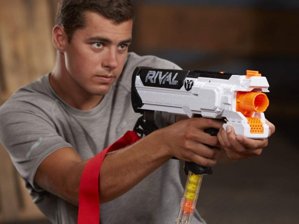 Man holding Nerf Phantom Rival NERF gun