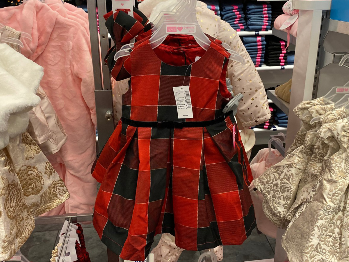 Children's Place Holiday dress hanging on rack