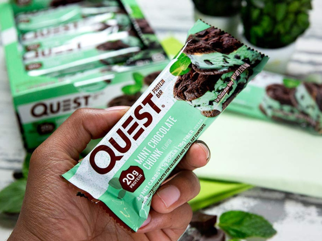 Hand holding Quest Mint Chocolate Chunk Protein Bars