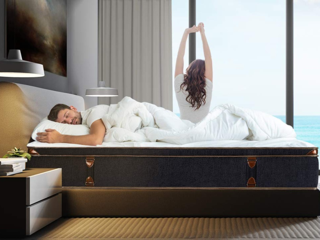 Man laying on BedStory Mattress with woman sitting