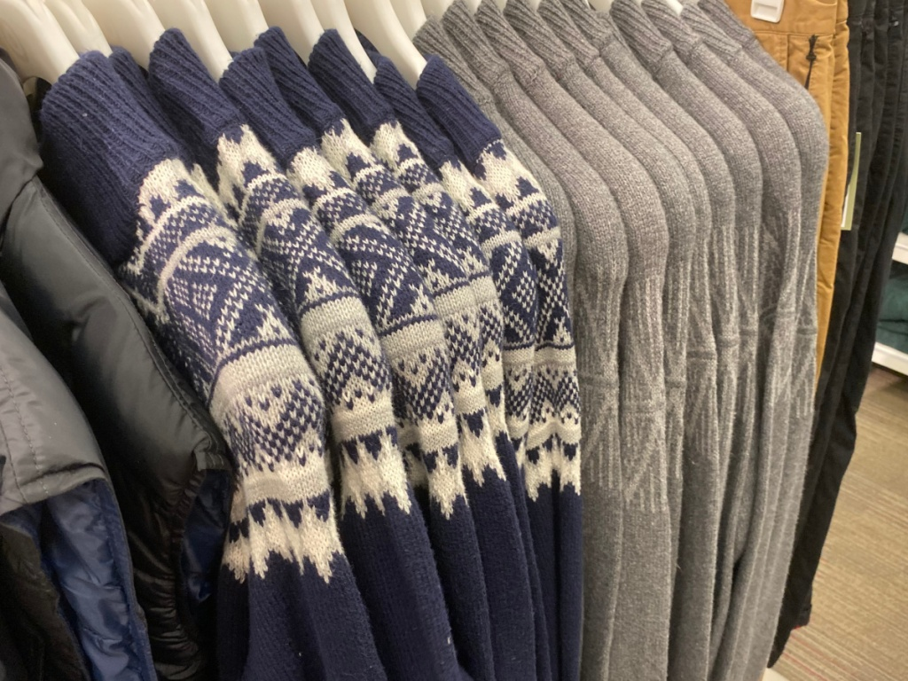 men's sweaters hanging on a target rack