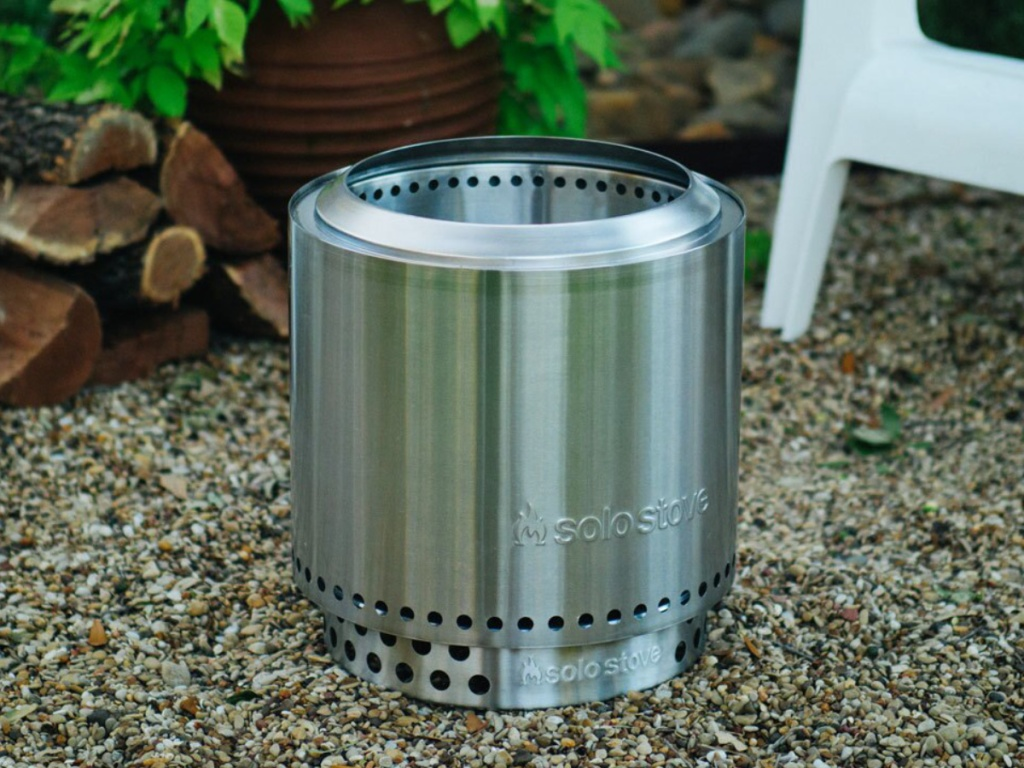 Solo Stover Stainless Steel/Silver Wood-Burning Fire Pit sitting on ground