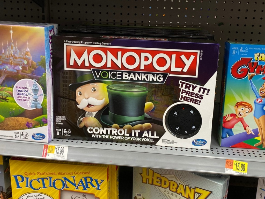 Hand holding Monopoly Voice Banking Electronic Family Board Game on Walmart shelf