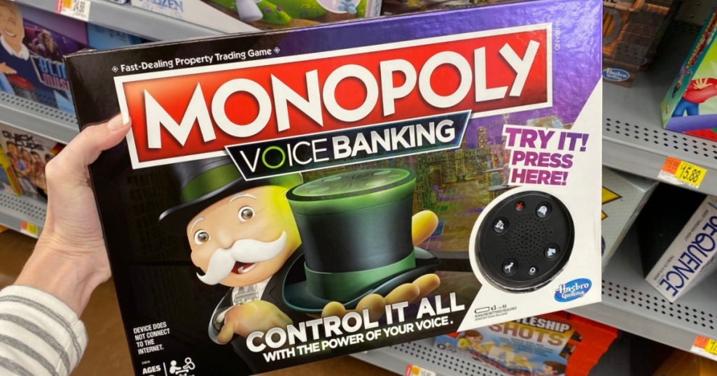 Hand holding Monopoly Voice Banking Electronic Family Board Game