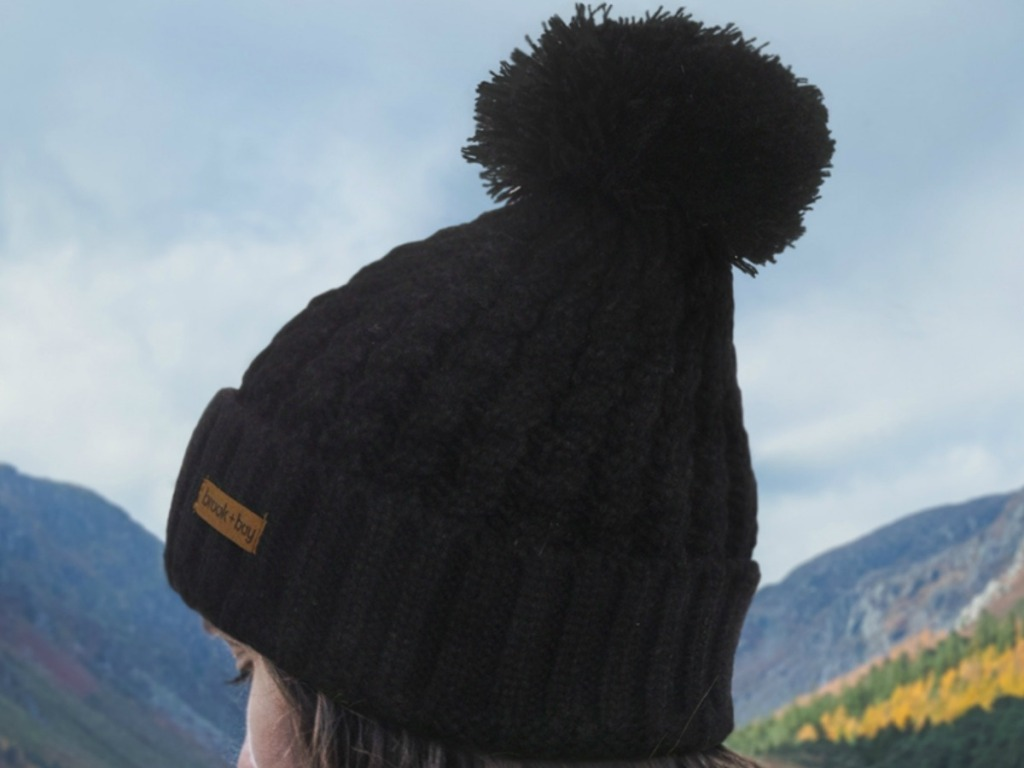 Woman wearing a black beanie hat