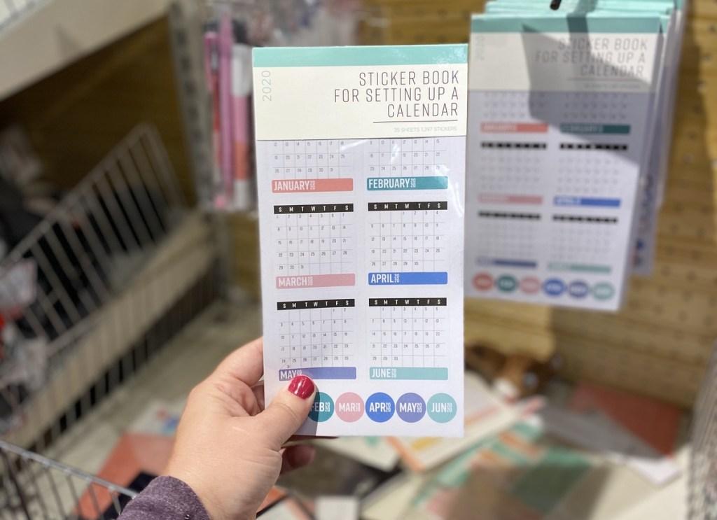 hand holding Calendar Sticker Book