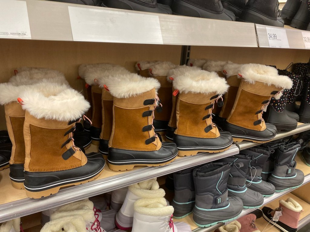 brown Cat & Jack Girls Constance Winter Boots on shelf at target