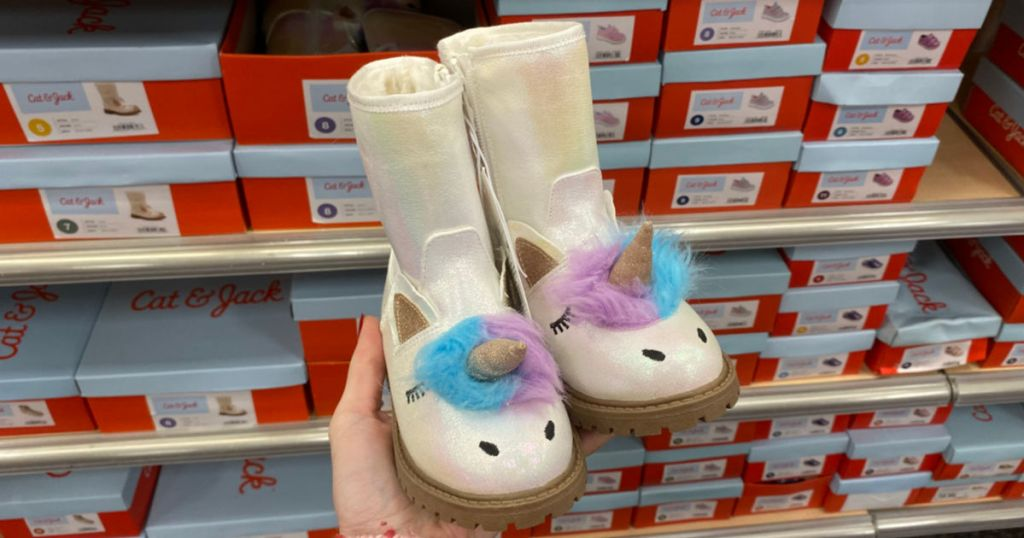 woman holding Cat & Jack Toddler Girls American Girl Hillary Fashion Boots in store