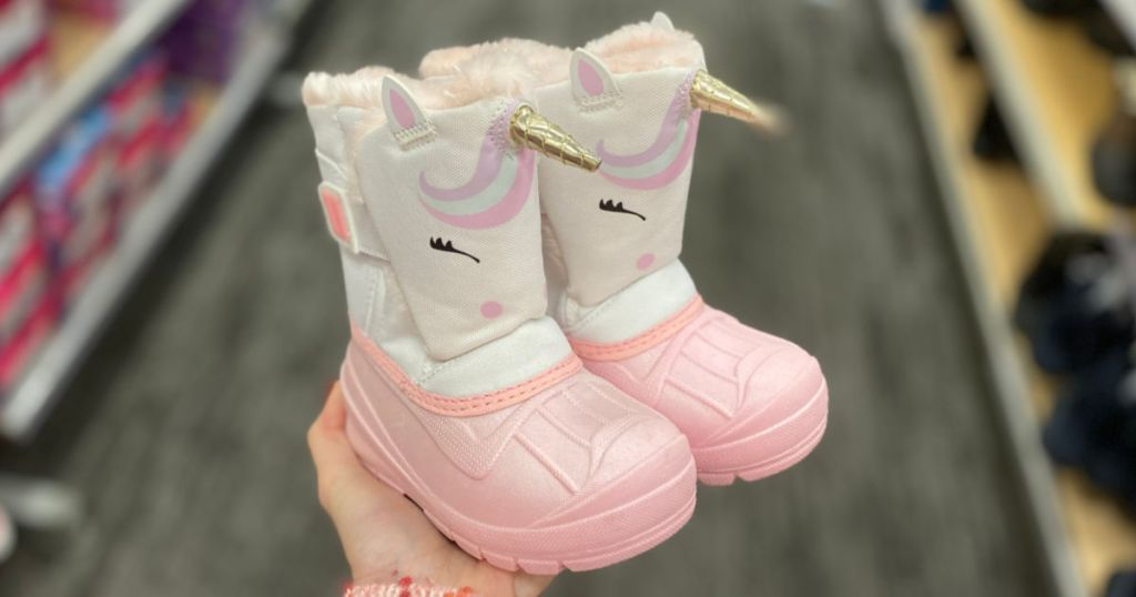 woman hand holding Cat & Jack Toddler Girls Huxley Winter Boots in store