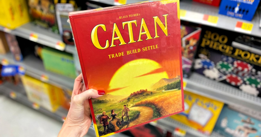 hand holding Catan Board Game