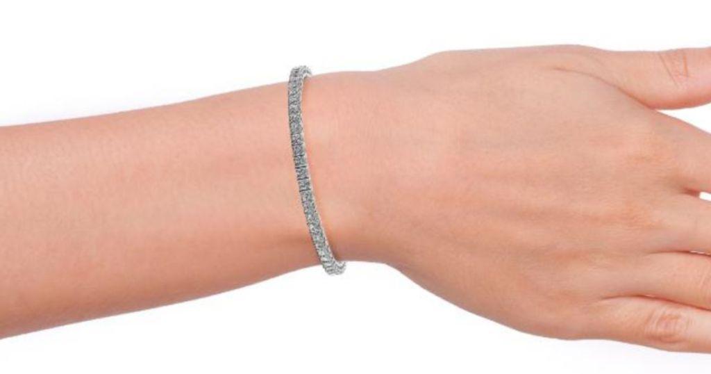 woman wrist wearing Cate & Chloe Leila 18k Gold Plated CZ Tennis Bracelet