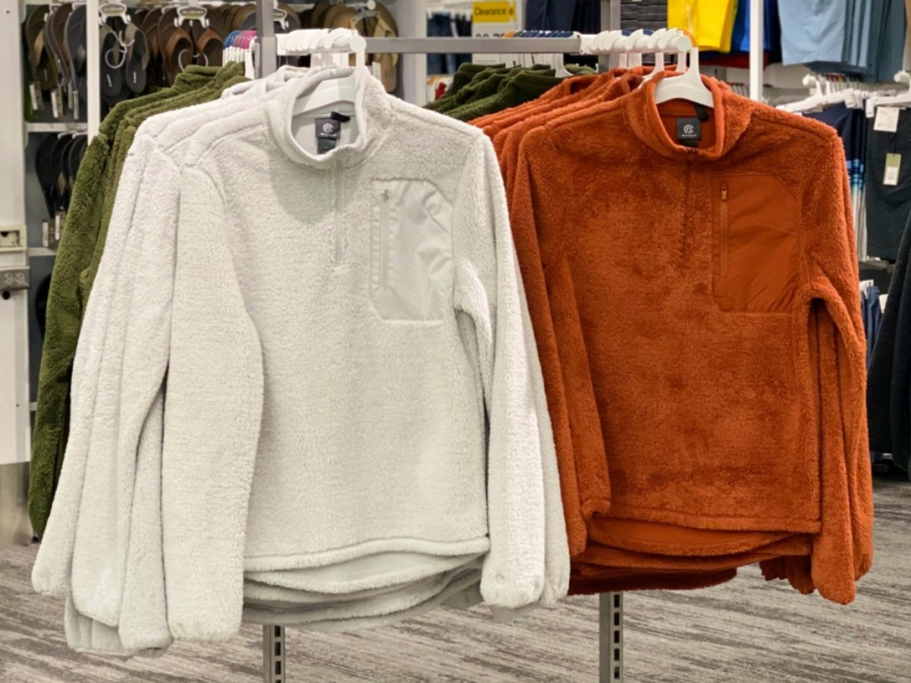 Champion brand Men's activewear jackets in white and orange on hangers in Target