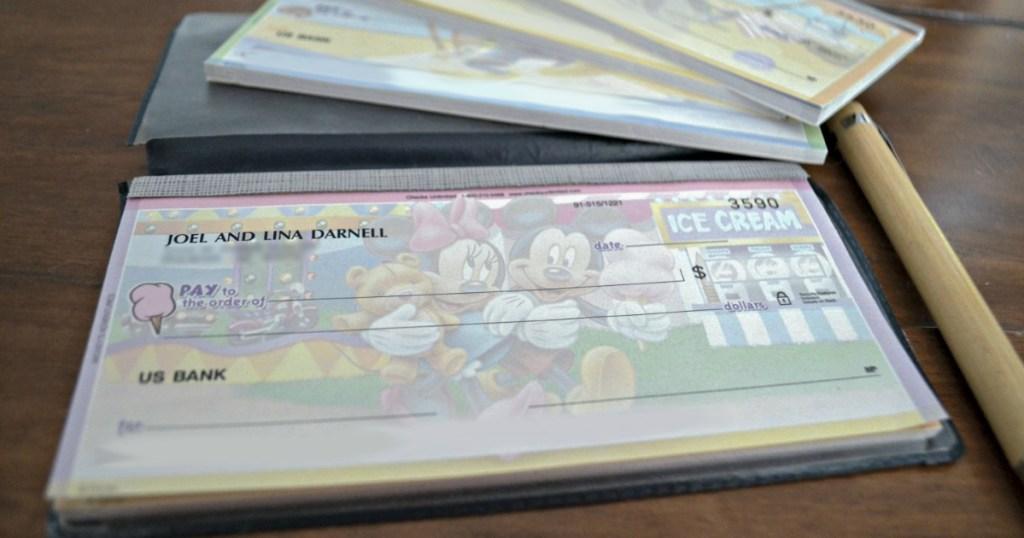Mickey Mouse checks in a checkbook