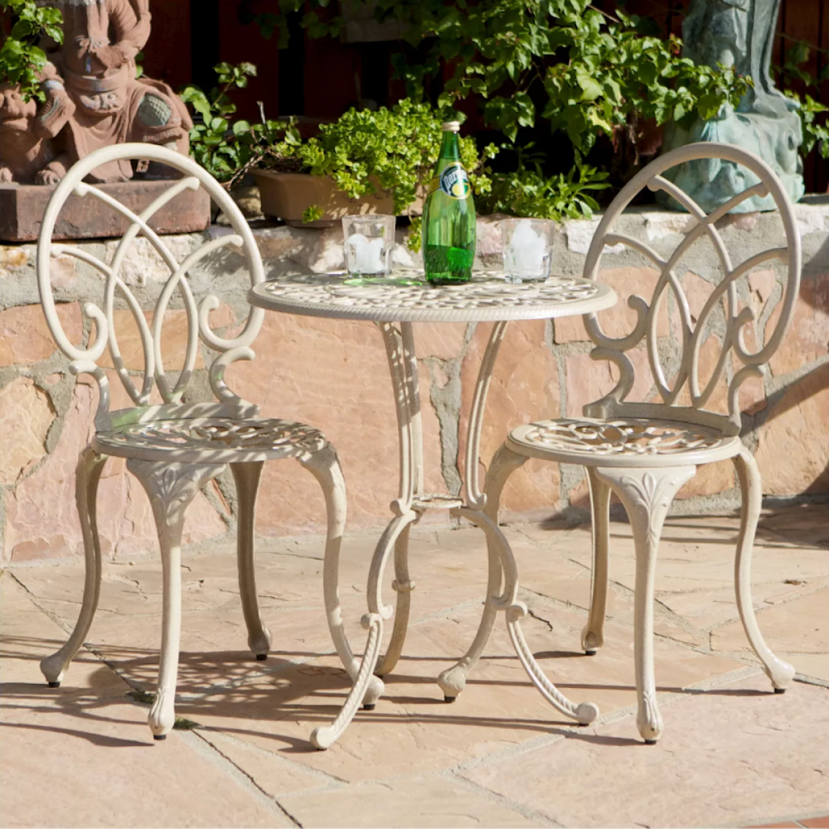 Christopher Knight Bistro Table on patio outstide with Perrier bottle and glasses on table