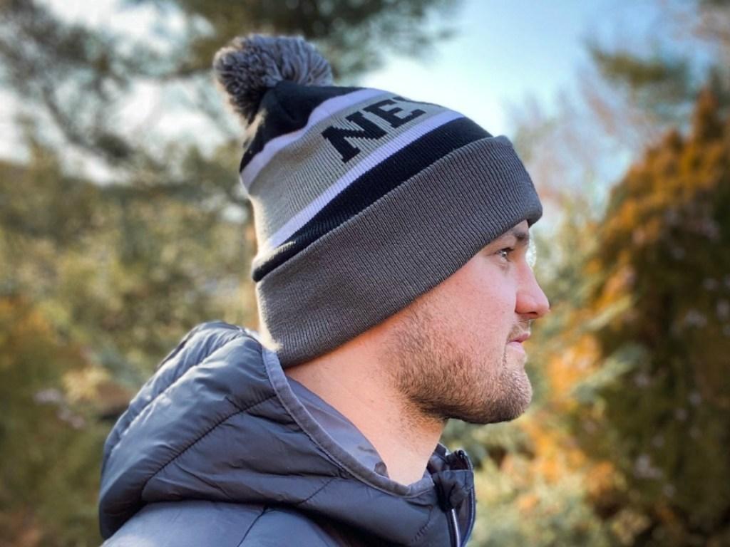 Man wearing gray Cirque Mountain beanie outdoors