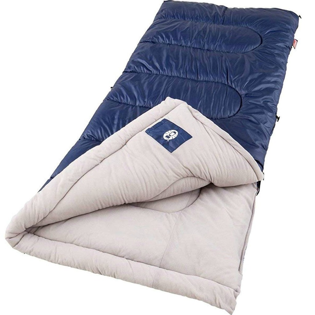 Navy blue sleeping bag zipped up with white inside