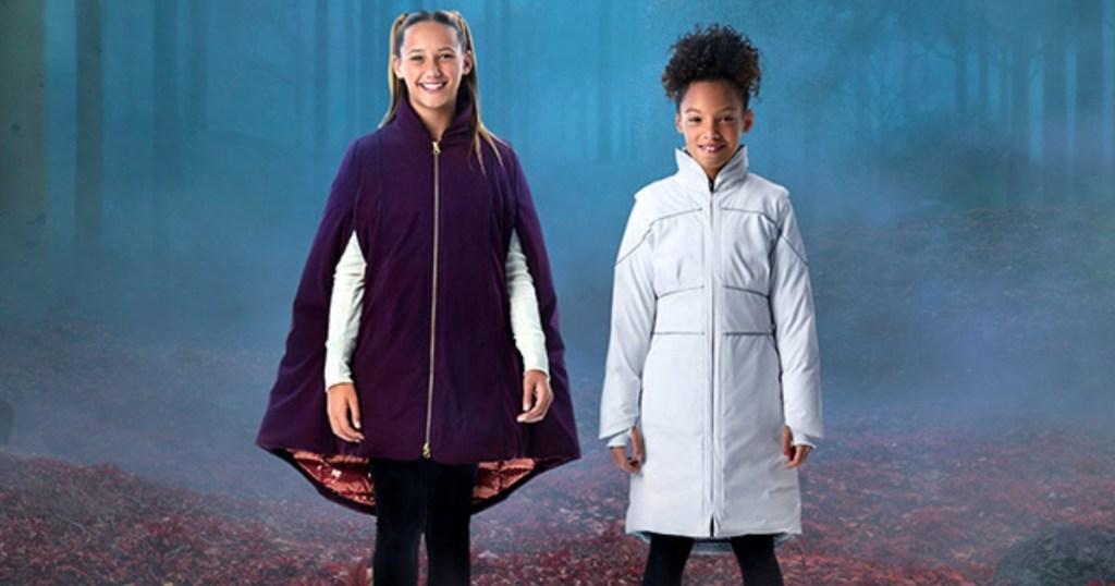 two girls wearing Columbia Frozen 2 coats
