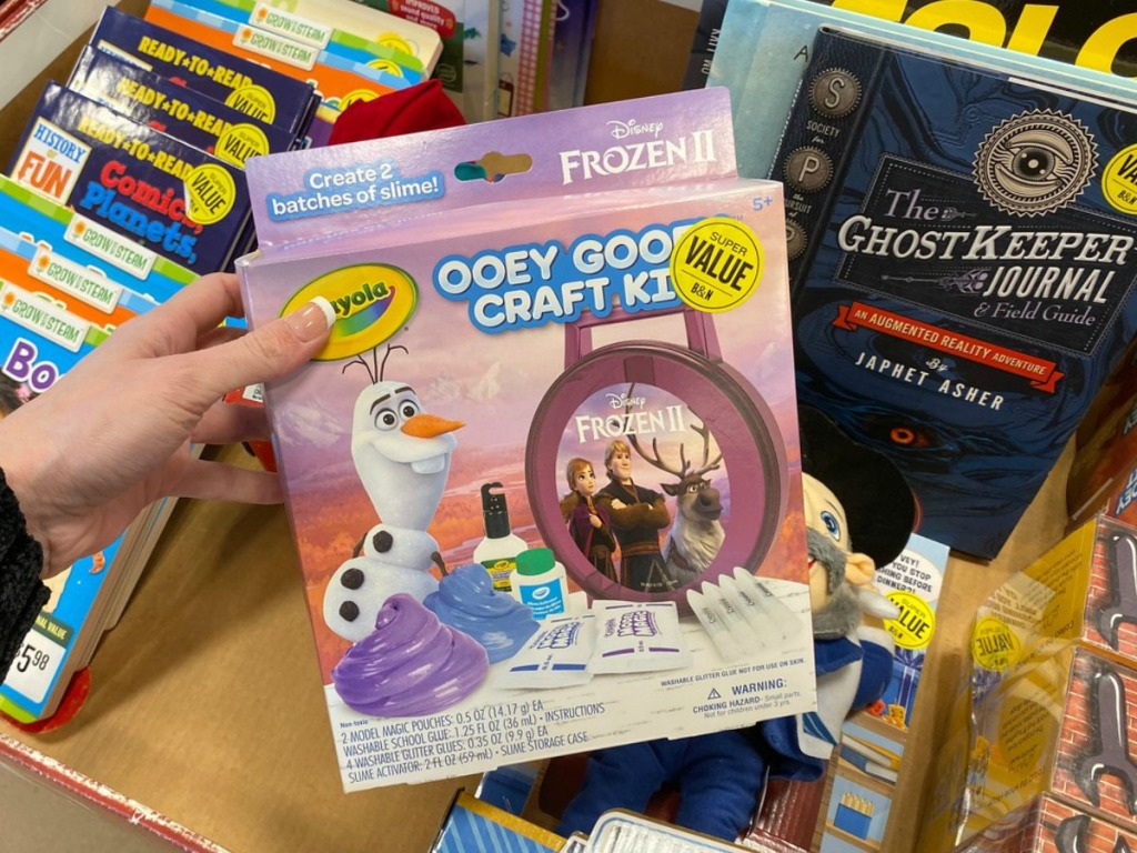 Crayola craft kit in hand at Barnes & Noble