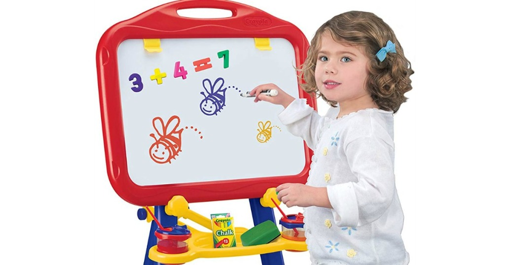 girl playing with Crayola dry erase board and chalk board