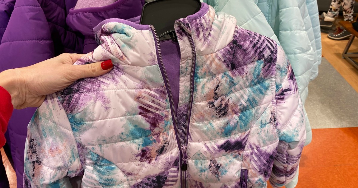 hand holding up DSG Print Insulated Jacket