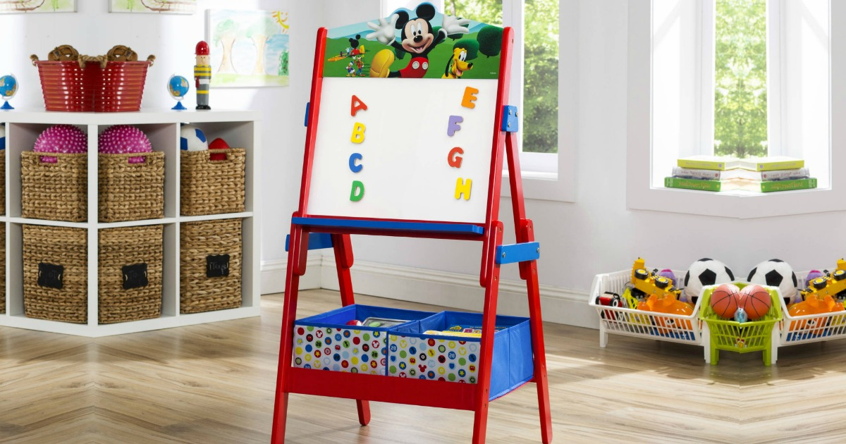 Delta brand art easel with Mickey Mouse theme, in kids bedroom with magnets
