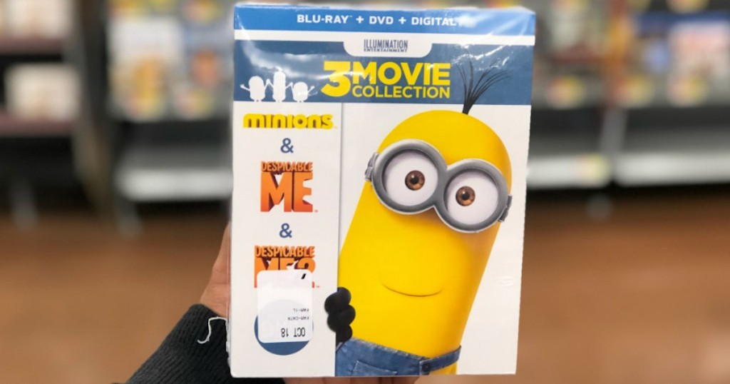 hand holding despicable me 3 movie collection in store