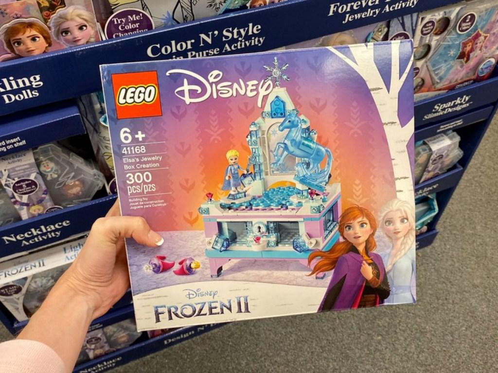 lady holding a Lego Disney Frozen 2 set
