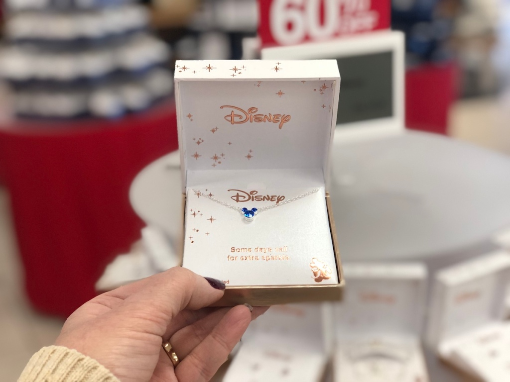 hand holding Disney Mickey Mouse Necklace box