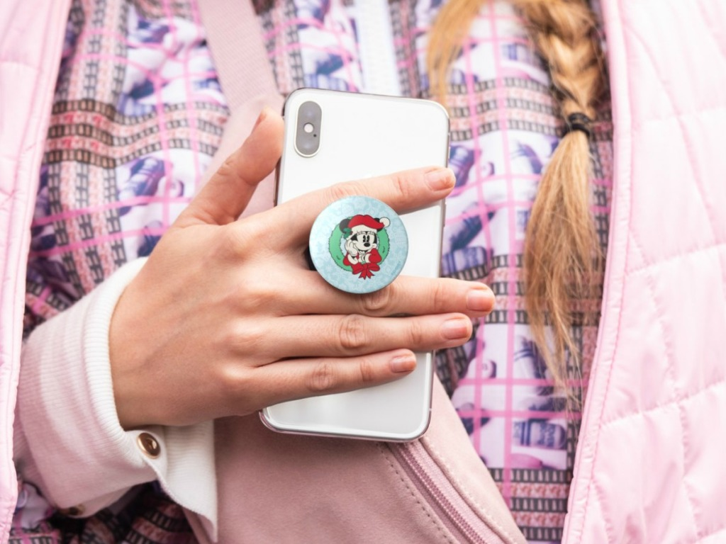 Girl holding phone with Disney Minnie Christmas PopGrip