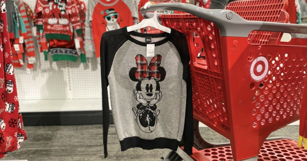 Disney Minnie Mouse Sweater hanging on Target cart