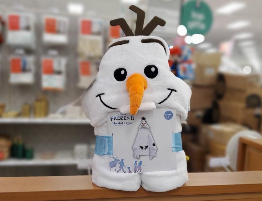 Disney Olaf Hooded Blanket on shelf at Target