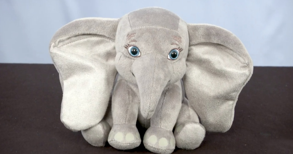 Disney's Dumbo Fluttering Ears Plush with blue and charcoal background