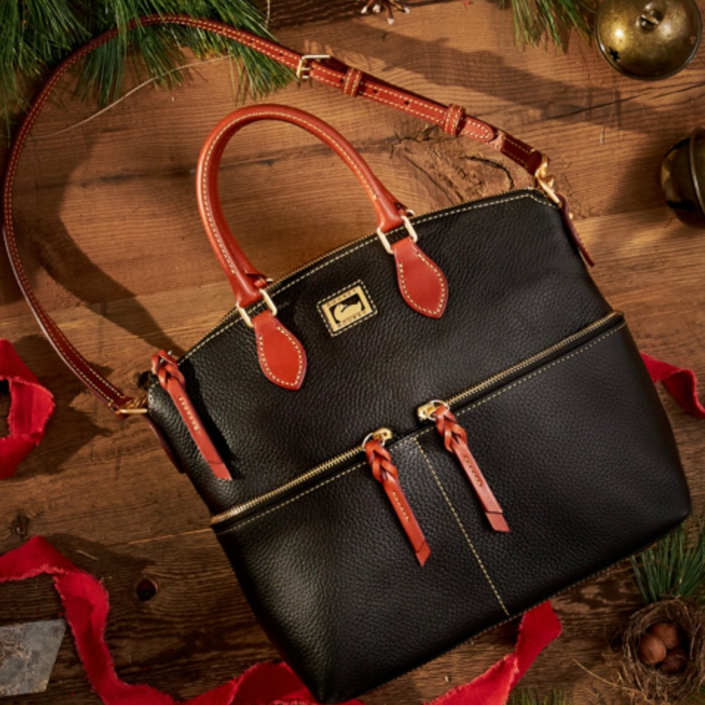 Luxury bag on wooden floor with rustic holiday decorations