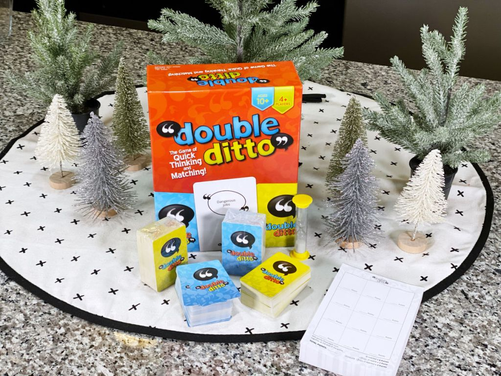 Double Ditto Board Game with christmas trees on white and black polka dot cloth