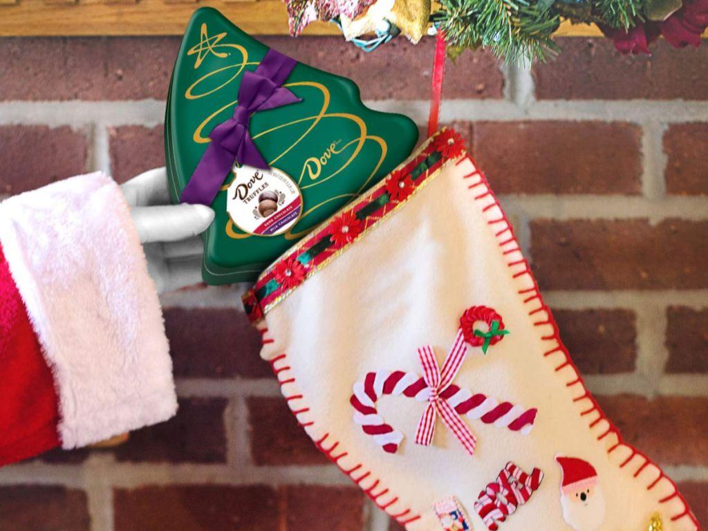 santa hand putting Dove Milk & Dark Chocolate Truffles Christmas Gift in stocking