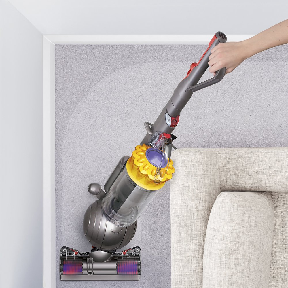 woman vacuuming with dyson vacuum