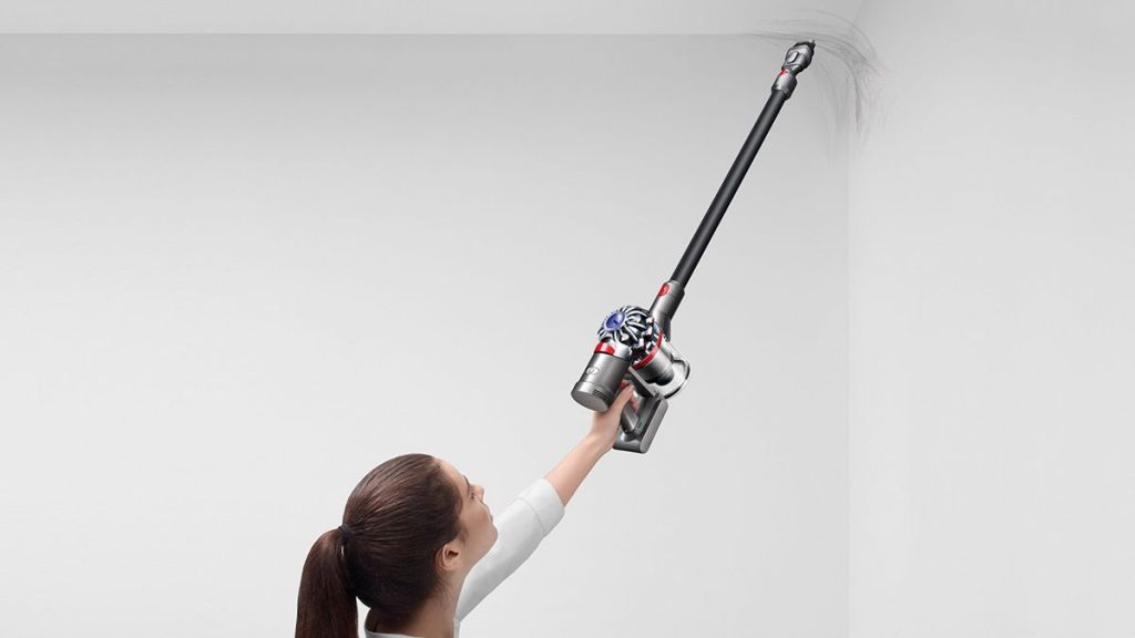 woman using a Dyson Vacuum