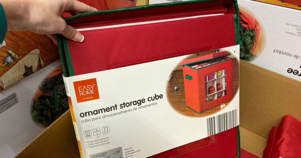 hand holding an Easy Home ornament storage cube